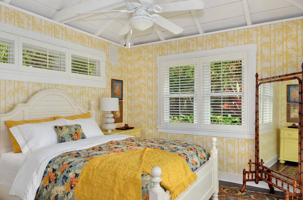 Bedroom - tropical bedroom idea in Hawaii with yellow walls