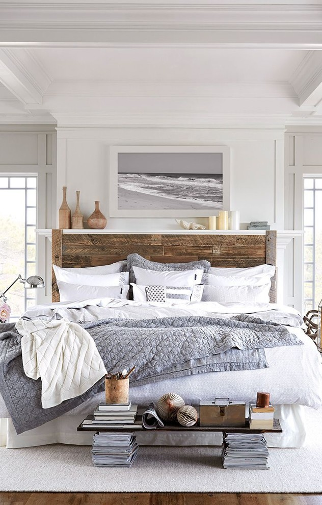 Example of a large beach style guest bedroom design in Minneapolis with white walls