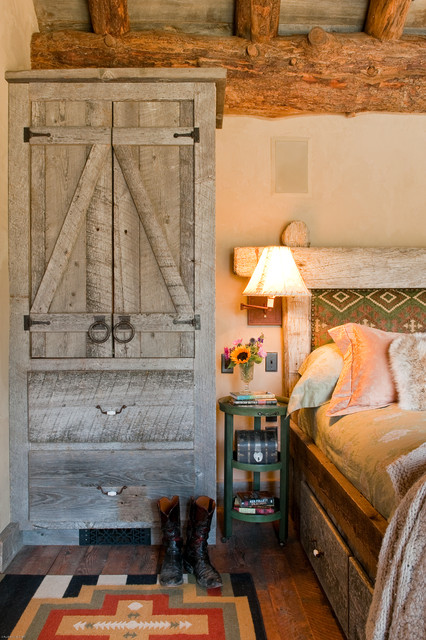 Rustic Bedroom by Dan Joseph Architects