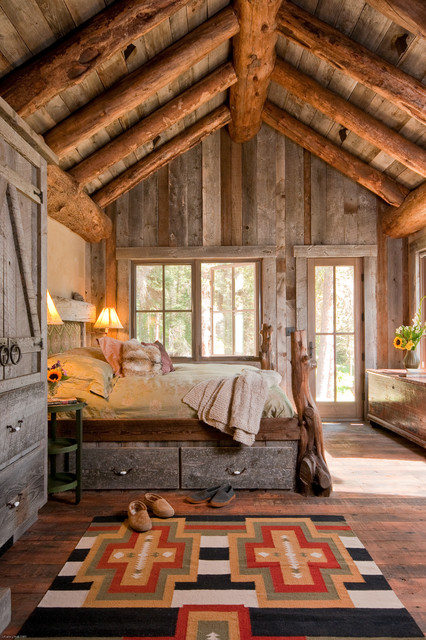 Merveilleux Bedroom   Rustic Medium Tone Wood Floor Bedroom Idea In Other With Beige  Walls
