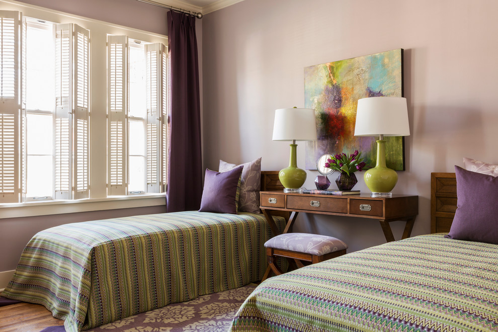 Inspiration for a mid-sized transitional guest medium tone wood floor bedroom remodel in Little Rock with purple walls