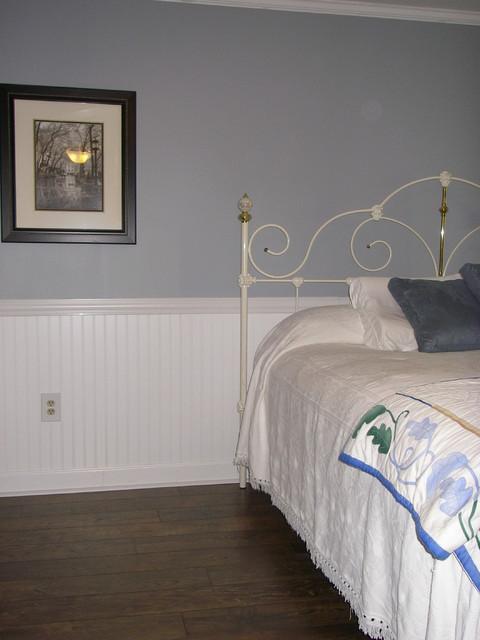 bedroom flooring crown molding wainscotting transitional bedroom