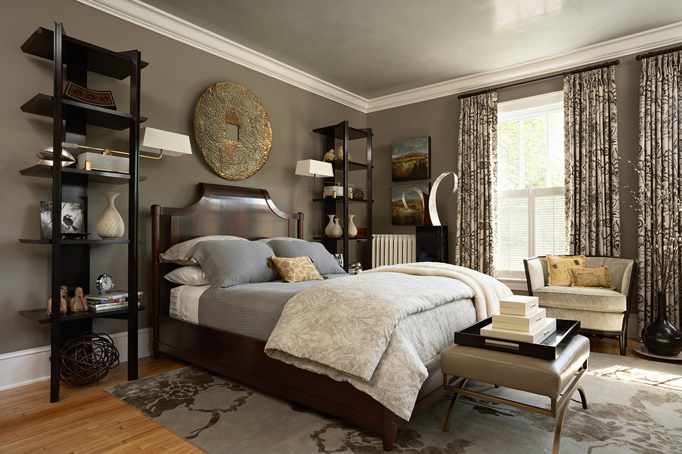 Transitional bedroom photo in Minneapolis with brown walls