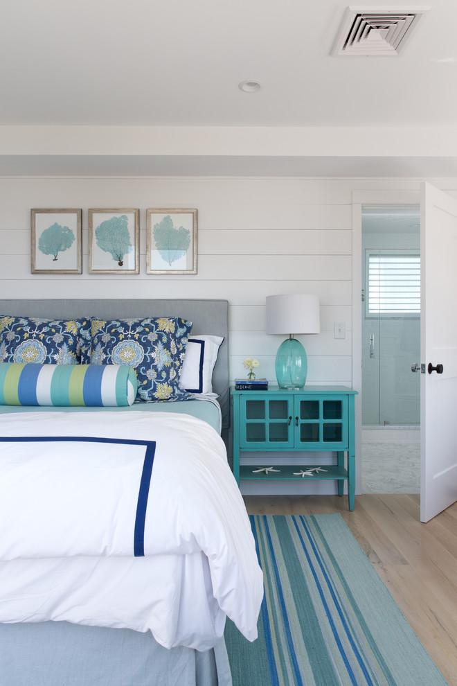 Bedroom - large coastal master light wood floor bedroom idea in Portland Maine with white walls