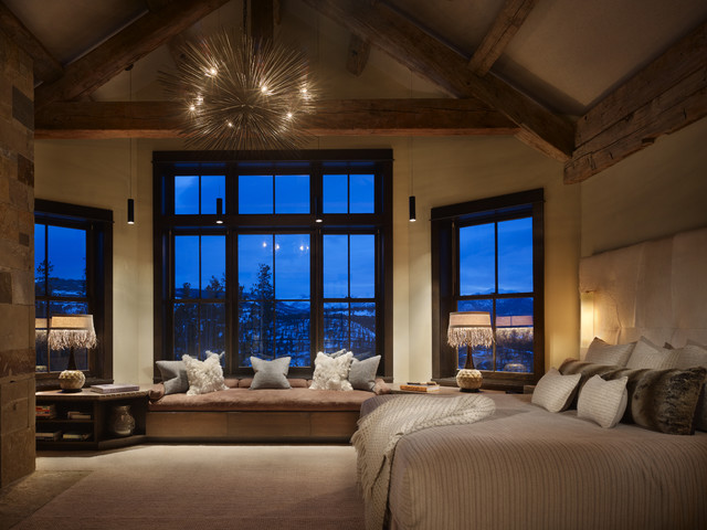 Example of a mountain style carpeted bedroom design in Denver with beige walls