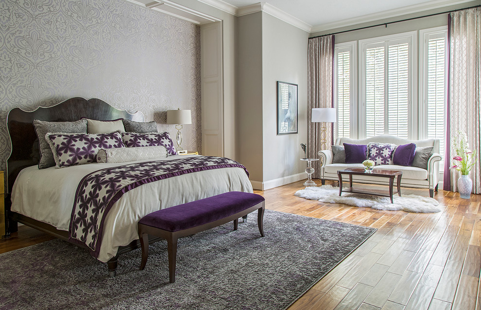 Example of a large transitional master medium tone wood floor bedroom design in Other with gray walls