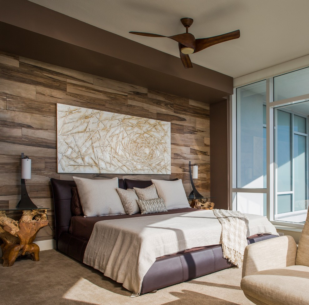 Example of a trendy carpeted bedroom design in Tampa with brown walls
