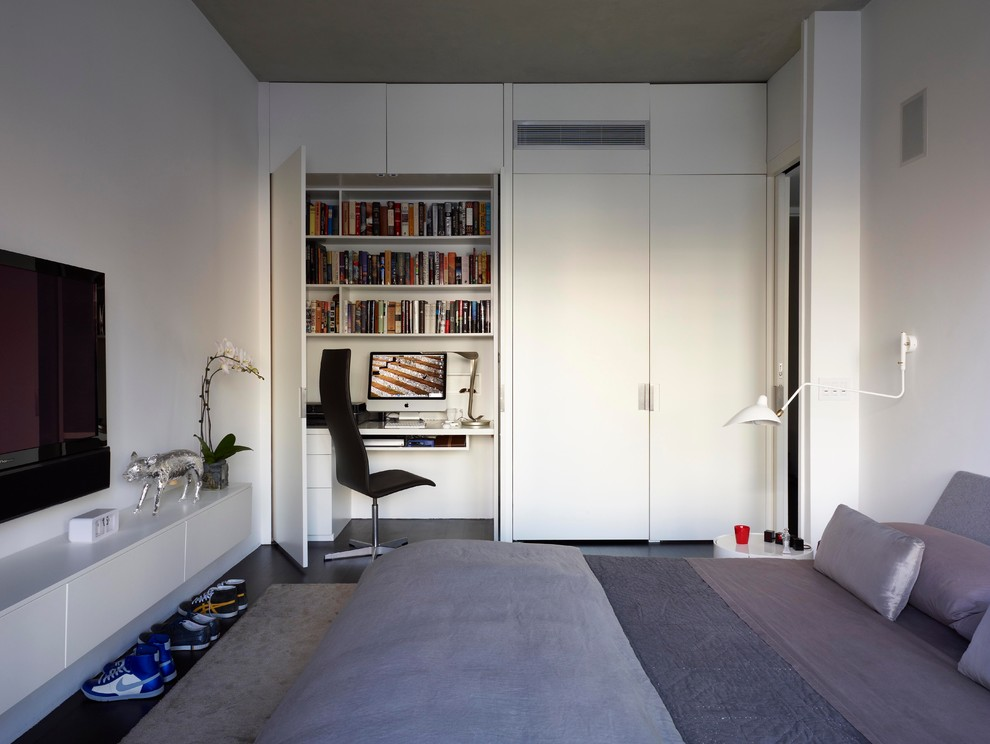 Minimalist dark wood floor bedroom photo in New York with white walls and no fireplace