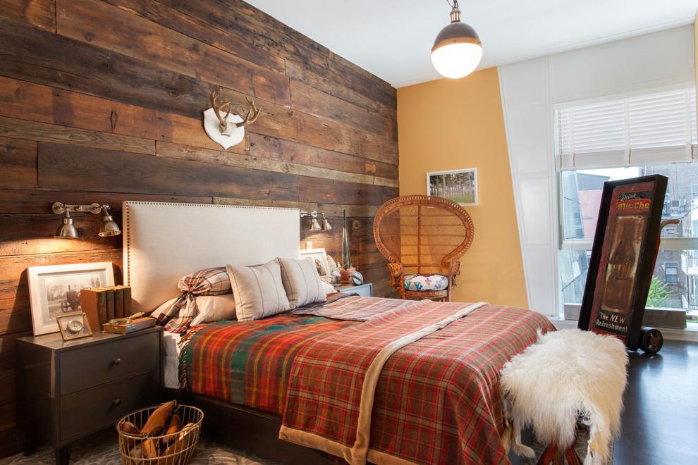 Bedroom - rustic guest dark wood floor bedroom idea in New York with orange walls