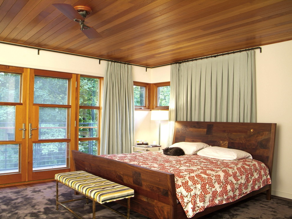 Mid-sized mountain style master carpeted and brown floor bedroom photo in Burlington with beige walls