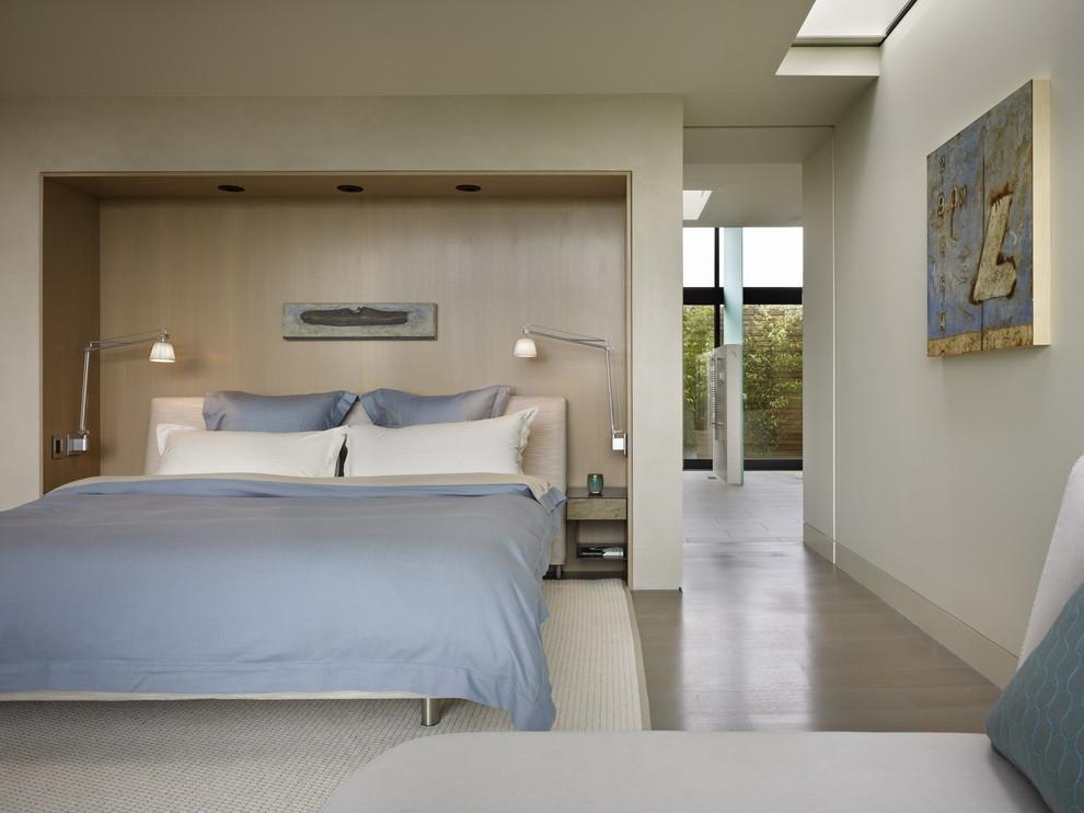 Bedroom - modern guest light wood floor bedroom idea in Seattle with white walls