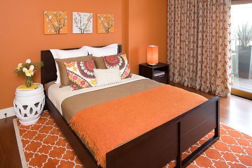 Hillside Sanctuary:  Tangerine guest bedroom by Kimball Starr Interior Design