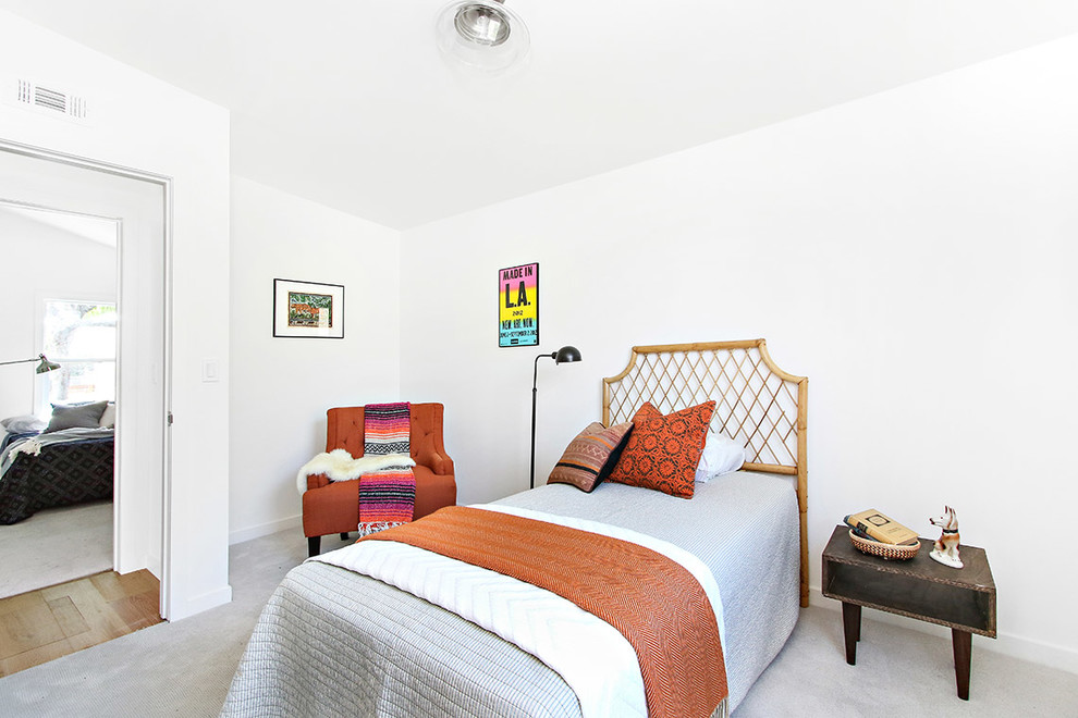 Example of an eclectic guest carpeted bedroom design in Los Angeles with white walls