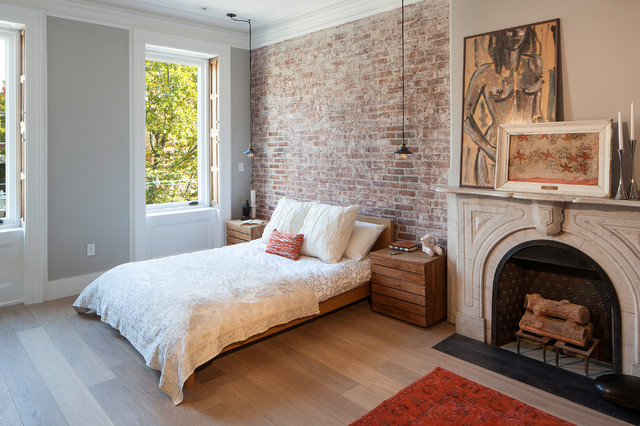 Example of a transitional master light wood floor bedroom design in New  York with gray walls