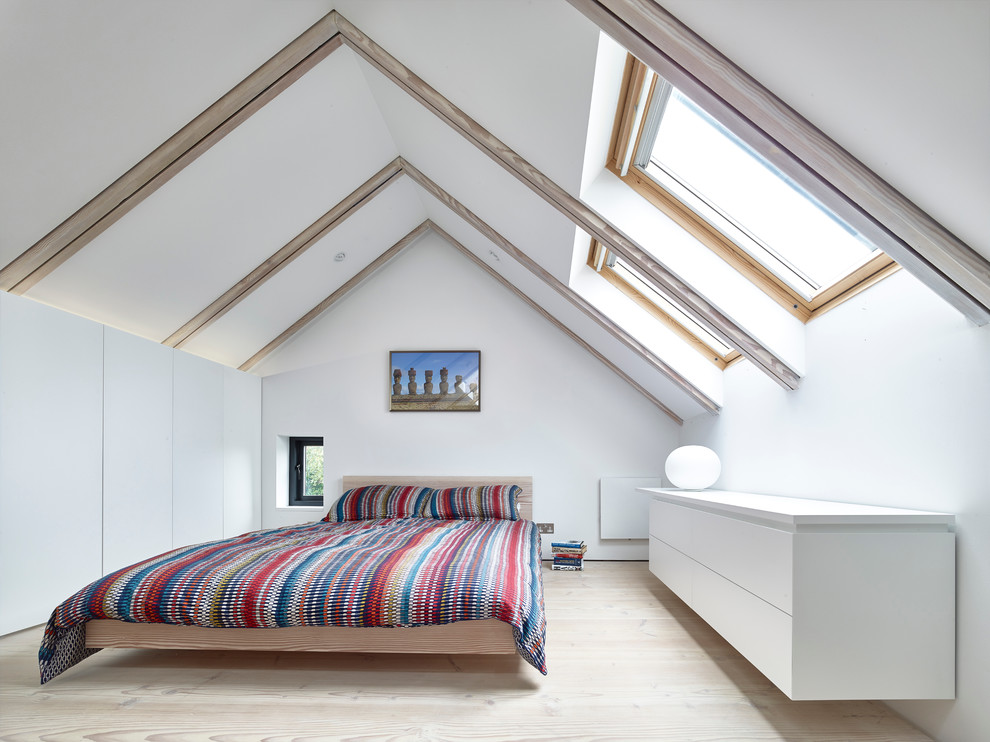 Trendy light wood floor bedroom photo in Manchester with white walls