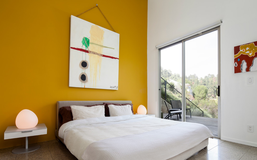 Inspiration for a mid-sized modern guest ceramic tile bedroom remodel in Los Angeles with yellow walls and no fireplace