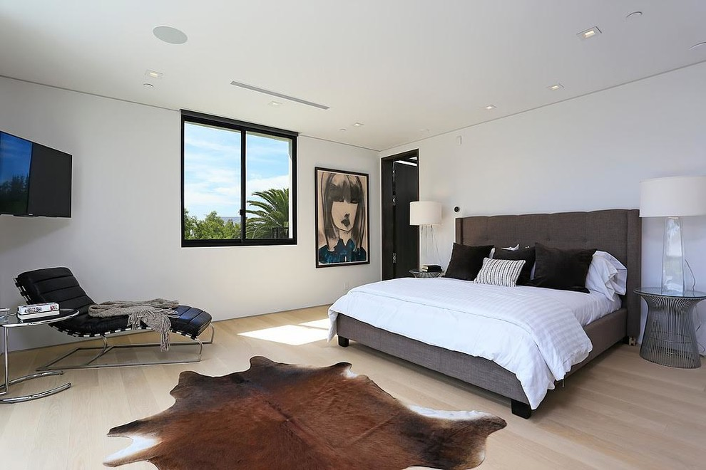 Example of a large trendy master light wood floor and beige floor bedroom design in Los Angeles with white walls and no fireplace
