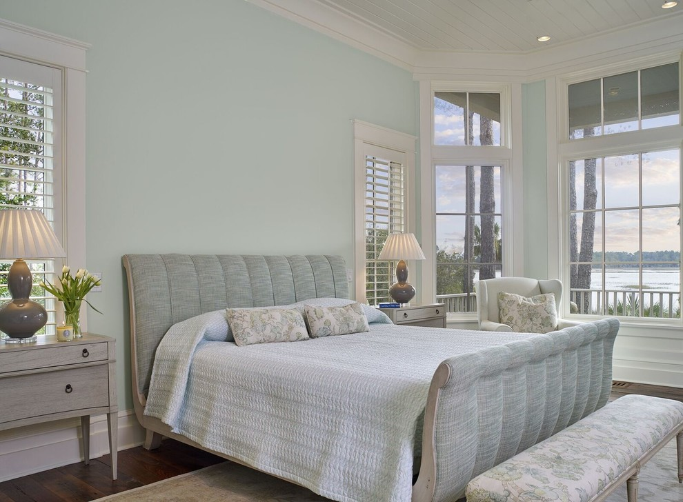 Inspiration for a mid-sized timeless master medium tone wood floor bedroom remodel in Atlanta with blue walls and no fireplace