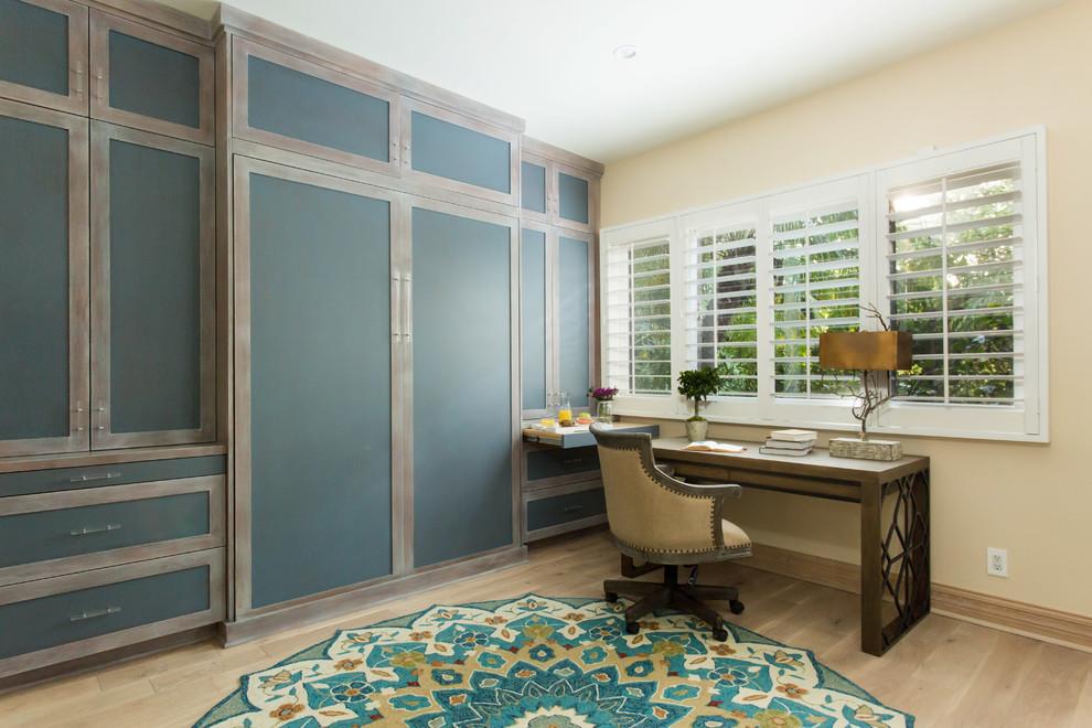 Bedroom - small country guest light wood floor and beige floor bedroom idea in Los Angeles with beige walls