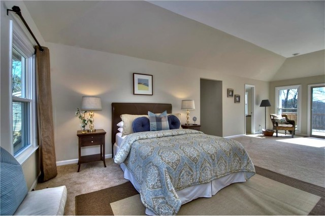 Example of a large classic master carpeted and beige floor bedroom design in Atlanta with beige walls