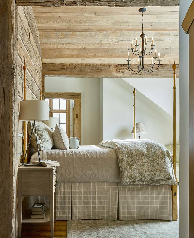 Inspiration for a rustic medium tone wood floor and brown floor bedroom remodel in Burlington with white walls