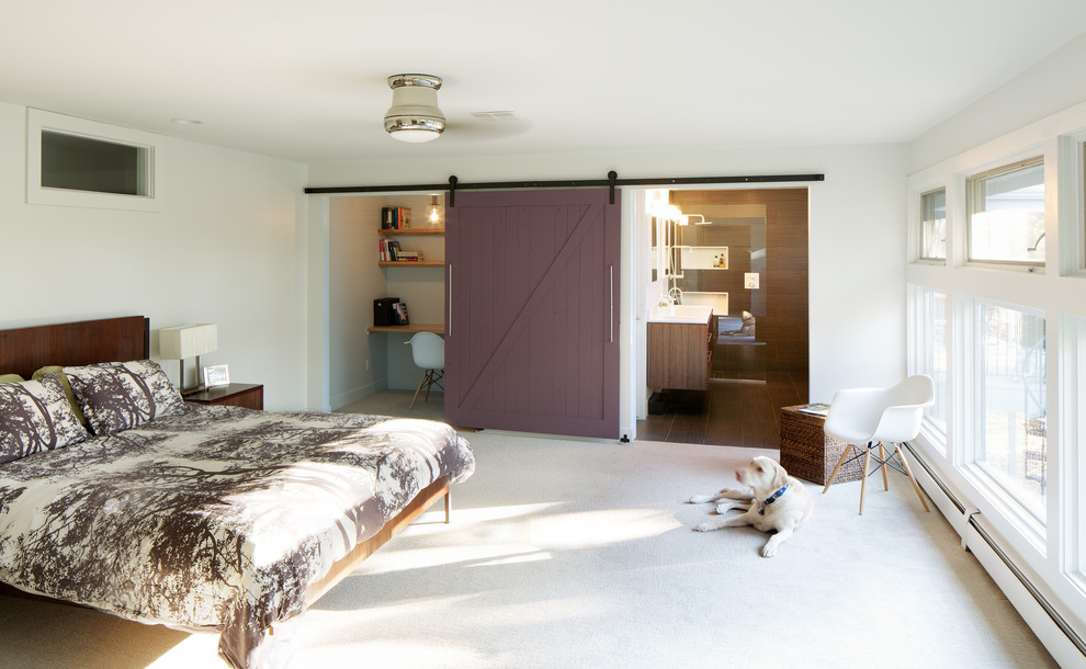 Example of a 1960s master carpeted bedroom design in Denver with white walls and no fireplace