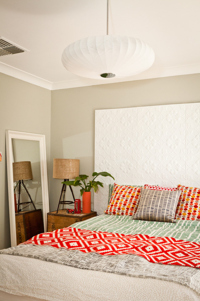 Example of a small eclectic bedroom design in Perth with gray walls