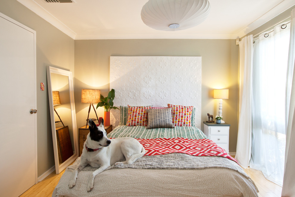 Example of a mid-sized trendy master medium tone wood floor bedroom design in Perth with beige walls