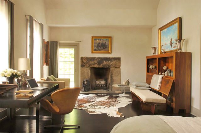 Example of a country brown floor bedroom design in New York with a stone fireplace