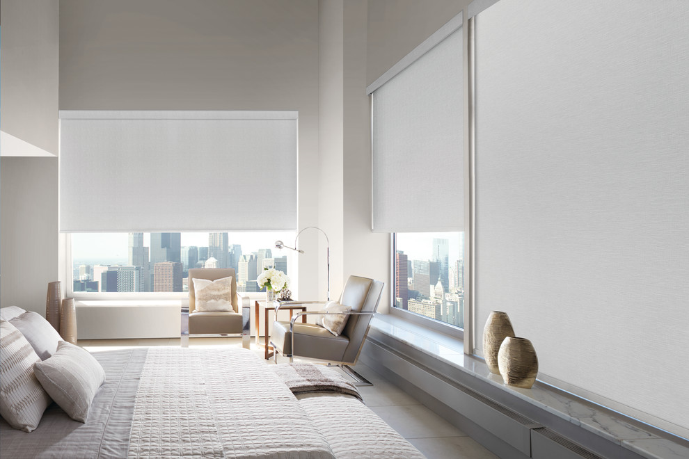 Large trendy master porcelain tile and beige floor bedroom photo in New York with beige walls and no fireplace