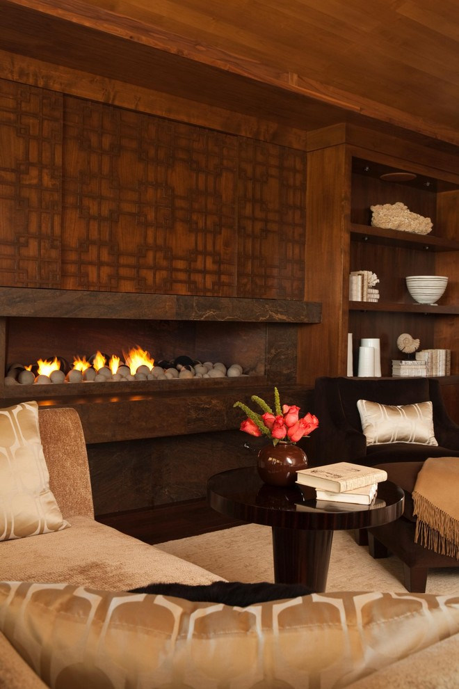 Inspiration for a contemporary bedroom remodel in Orange County with a ribbon fireplace
