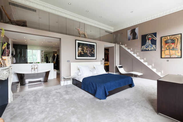 Inspiration for a huge contemporary master carpeted bedroom remodel in  London with gray walls