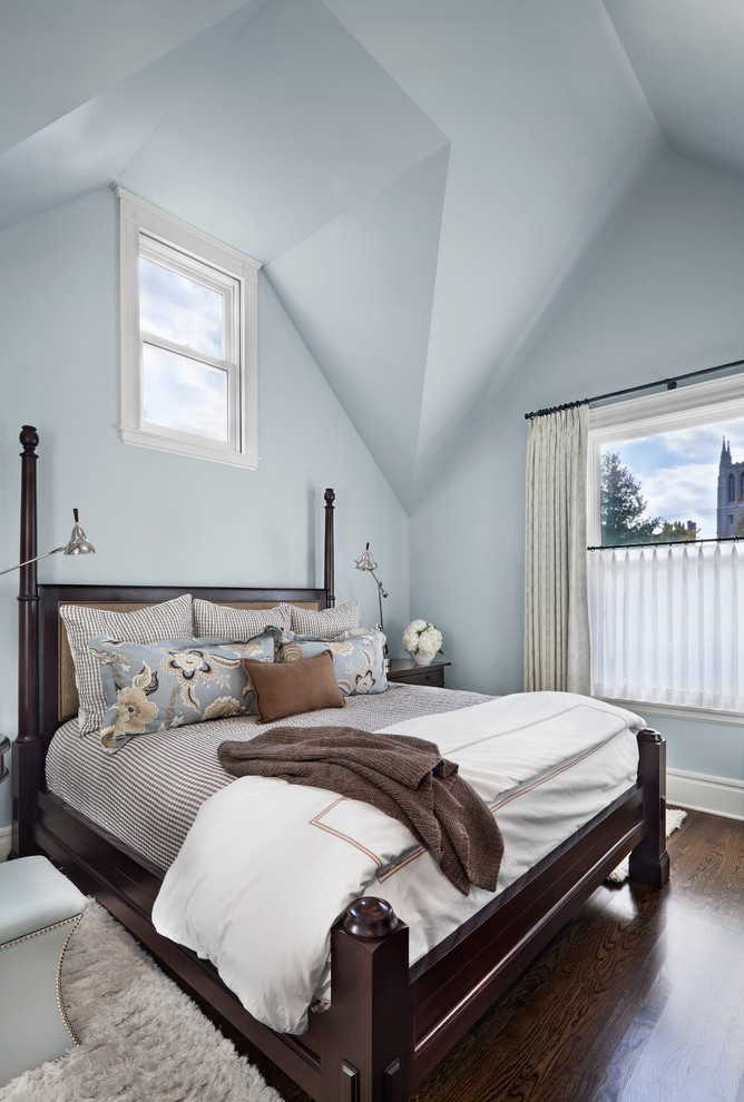 Example of a transitional bedroom design in Chicago with blue walls
