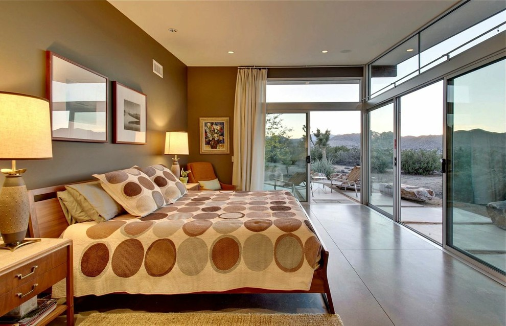 Inspiration for a large 1950s master concrete floor bedroom remodel in Other with brown walls