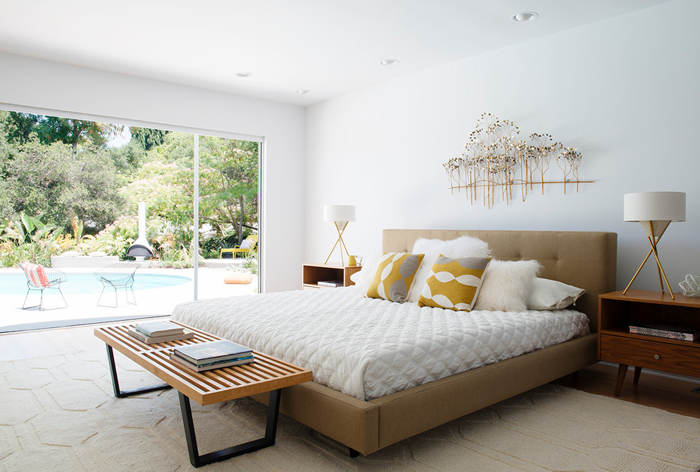Bedroom - large mid-century modern master medium tone wood floor and brown floor bedroom idea in Los Angeles with gray walls and no fireplace