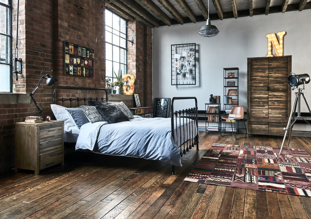 Bedroom - industrial master dark wood floor and brown floor bedroom idea in Other with white walls