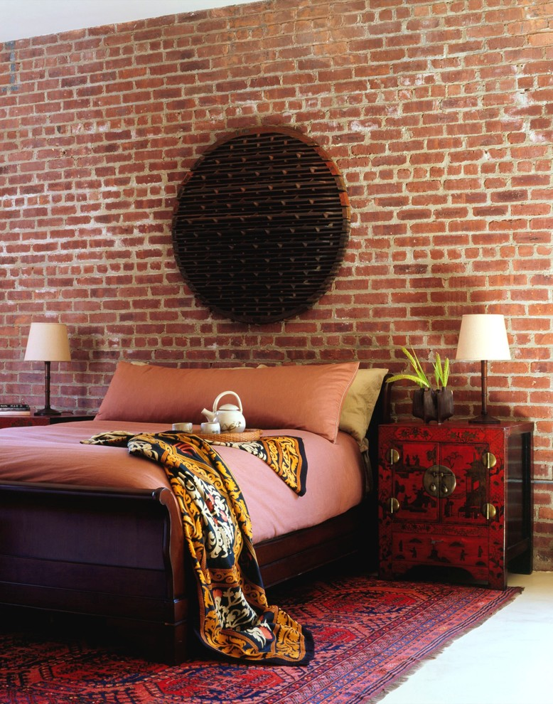 Inspiration for an industrial bedroom remodel in New York with red walls