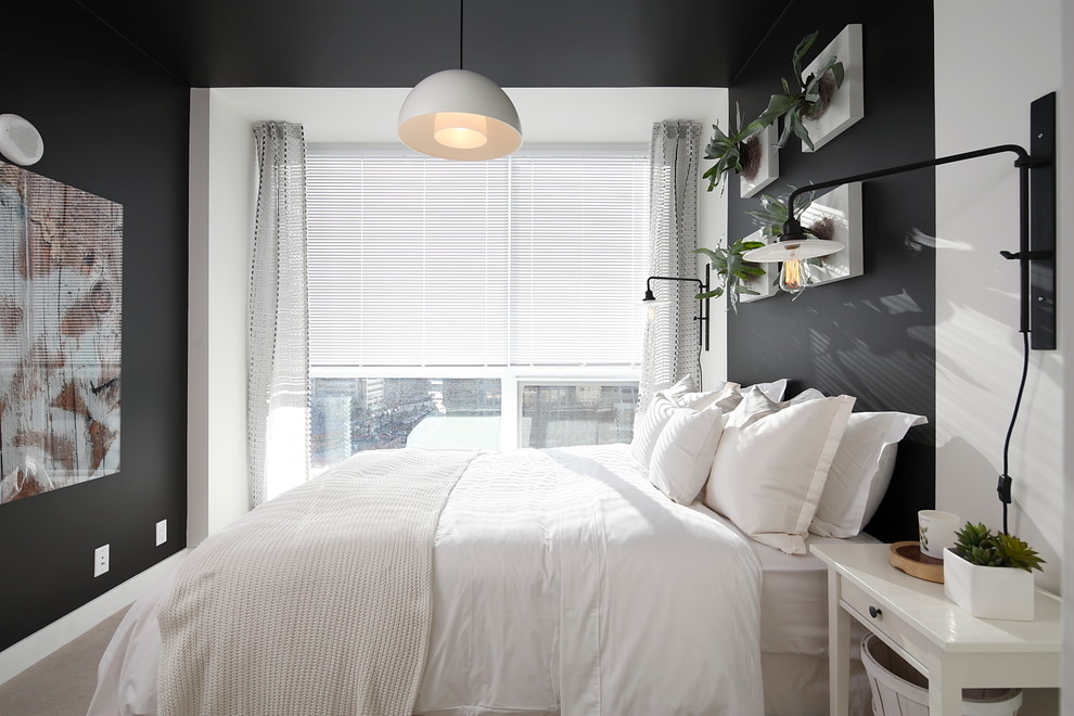 Trendy bedroom photo in Calgary with black walls