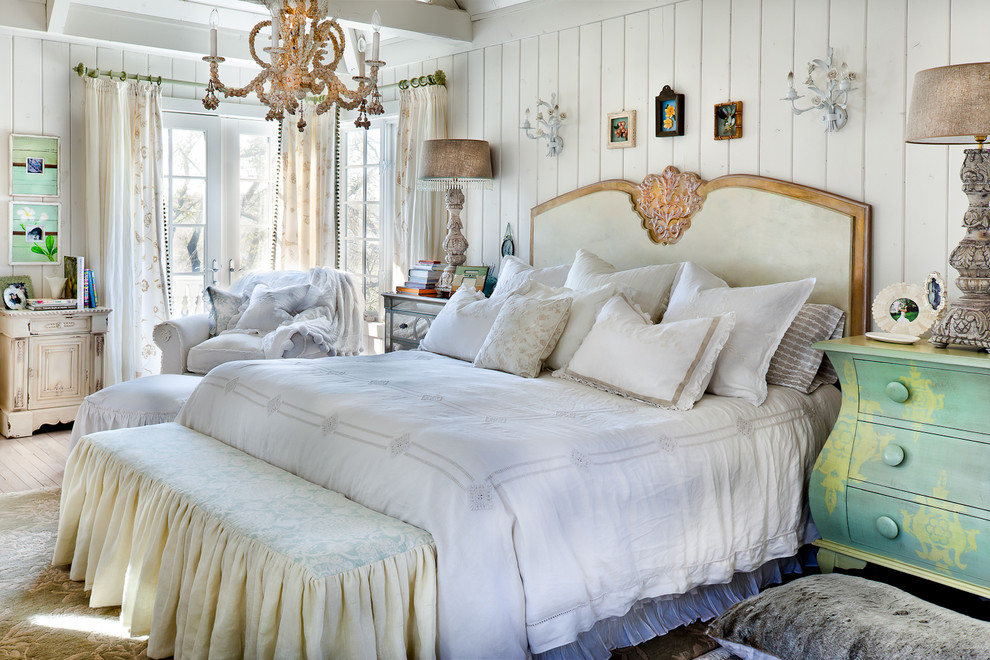 Example of a cottage chic light wood floor bedroom design in Kansas City with white walls and no fireplace