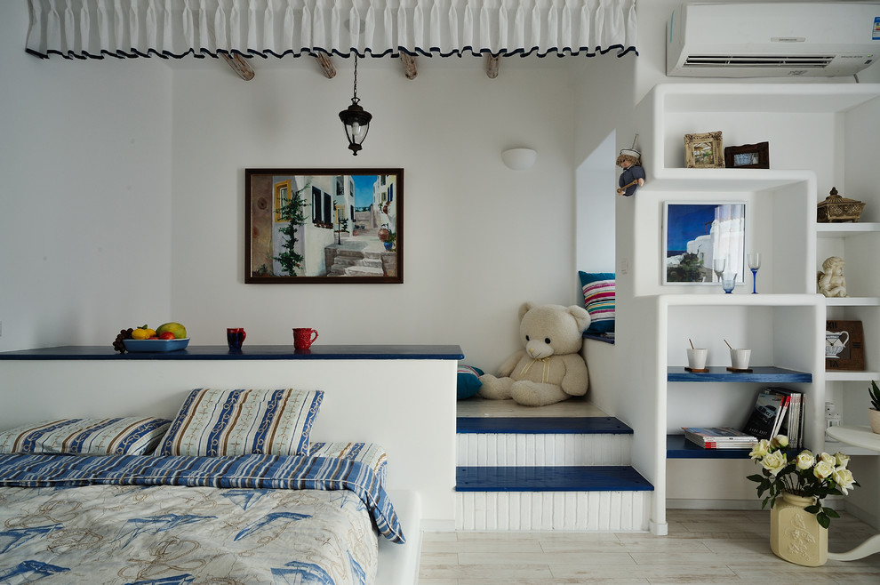 Inspiration for a mediterranean bedroom remodel in Hong Kong with white walls