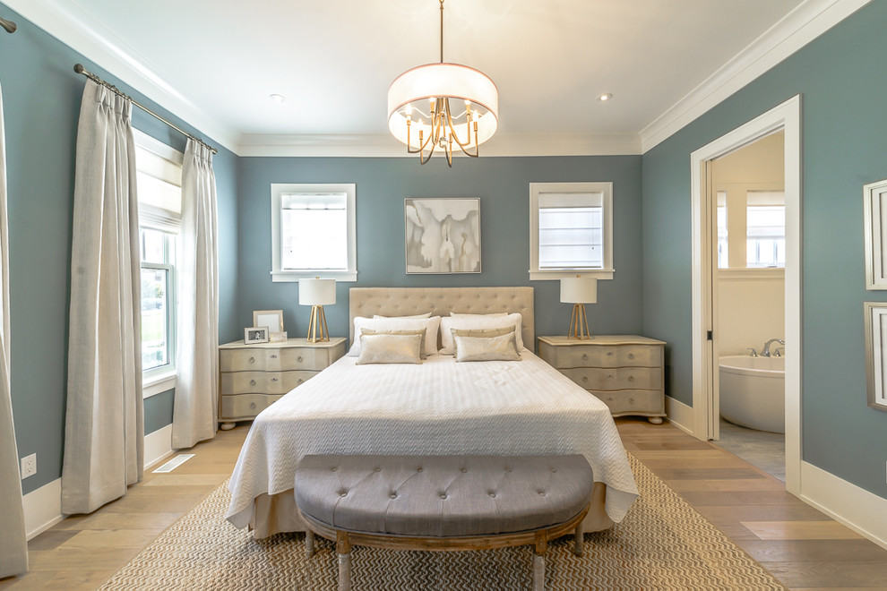 Elegant master light wood floor bedroom photo in Toronto with blue walls and no fireplace