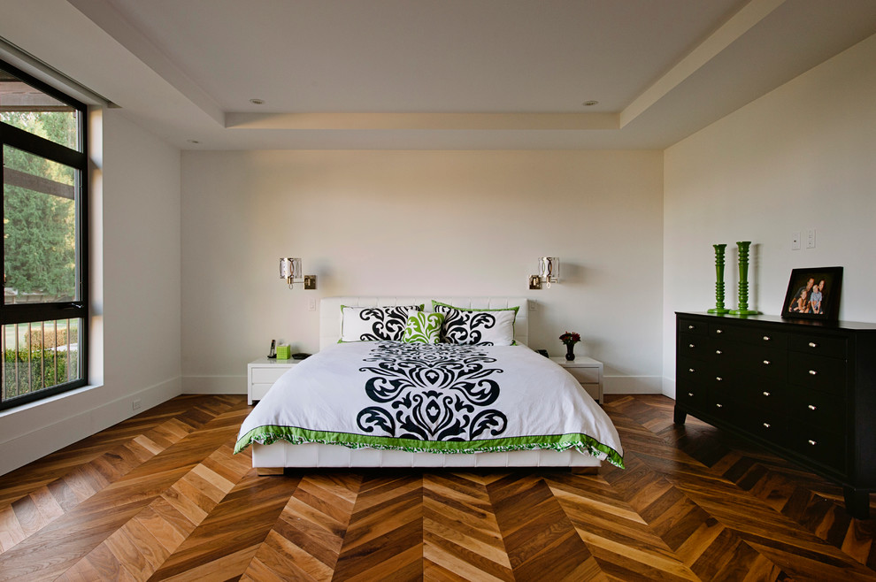 Example of a trendy medium tone wood floor and brown floor bedroom design in Vancouver with white walls