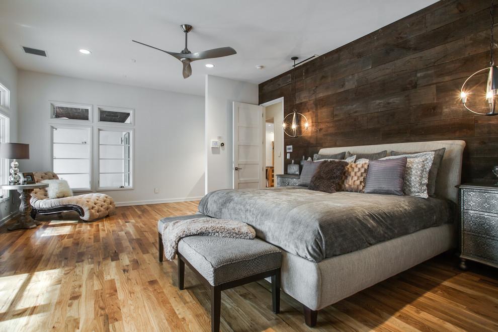 Bedroom - contemporary master medium tone wood floor and brown floor bedroom idea in Dallas with white walls