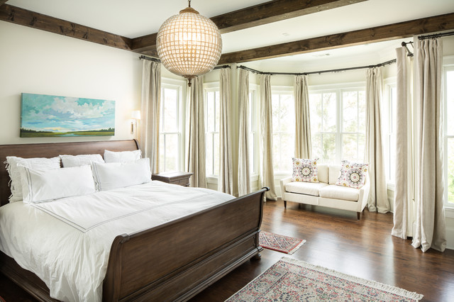 Inspiration for a mid-sized timeless master medium tone wood floor bedroom  remodel in Atlanta