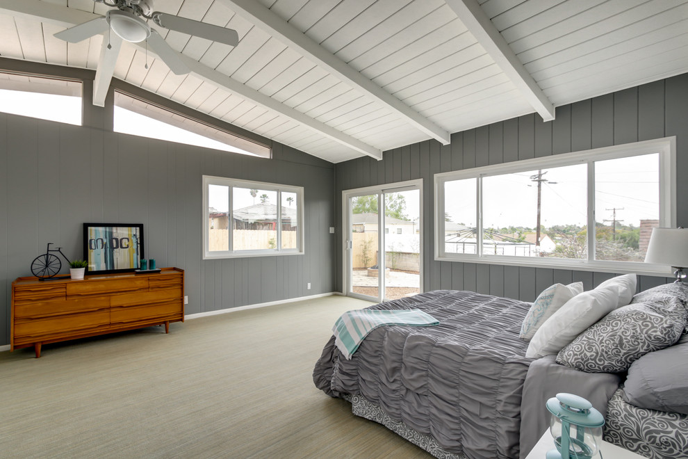 Inspiration for a large modern master carpeted bedroom remodel in San Diego with gray walls and no fireplace
