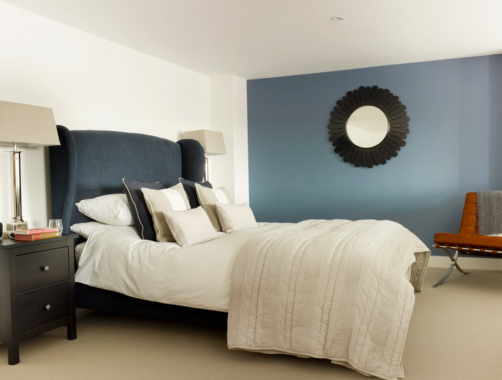 Small transitional master carpeted bedroom photo in London with blue walls