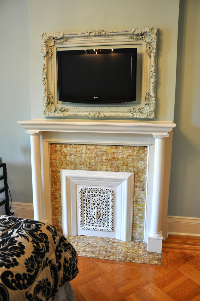 Example of a classic bedroom design in New York with a tile fireplace and a standard fireplace