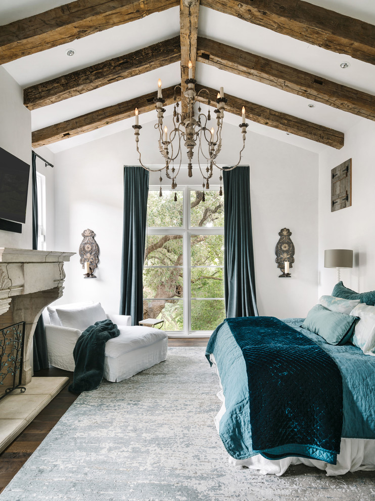 Inspiration for a mediterranean master dark wood floor bedroom remodel in Austin with white walls and a standard fireplace