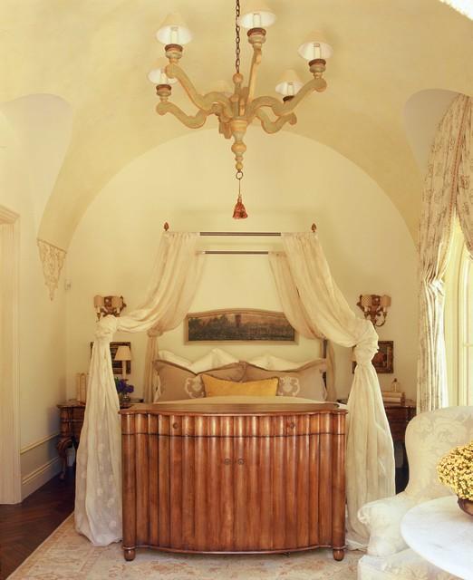 Example of a classic dark wood floor bedroom design in Orange County with beige walls