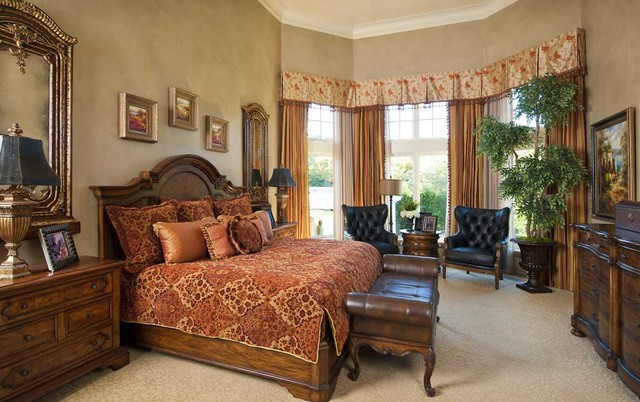 Inspiration for a large mediterranean master carpeted bedroom remodel in Dallas with beige walls